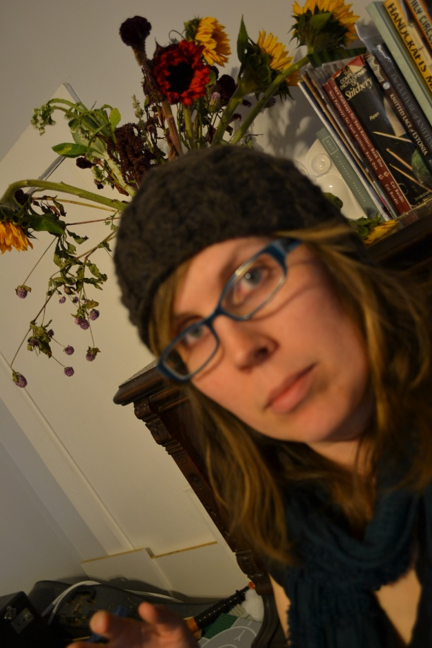 For every good photo you see, there are about 4x more terrible ones at home on my hard drive.  I apparently have dead flowers growing out of my blurry head, and you can barely even see the hat here.